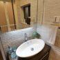 洗面 壁面、床面にタイル張り施工し、更にオシャレな洗面ボールを使用。まるでホテルのような洗面台にする事も可能です。(弊社施工事例)