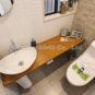 トイレ 便器も便座もお掃除簡単で汚れに強い一体型シャワートイレ。お色味の選択も可能。節水トイレですので、無駄なく賢く自動で節約してくれます。このように壁面・床面のタイル施工も可能です。(弊社施工事例)